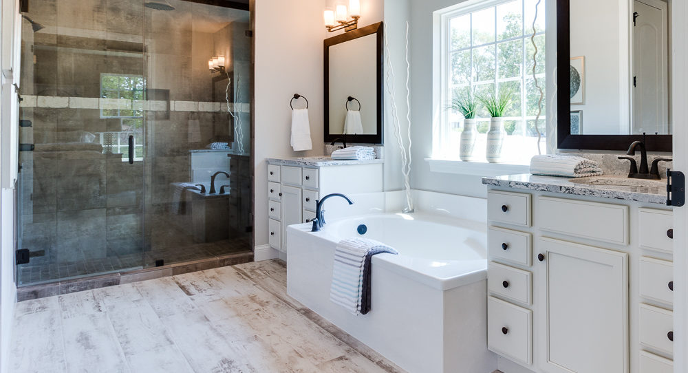 Owner's Retreat with double vanities and separate tub and shower