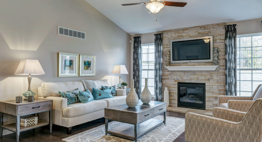 Gathering Room with Vaulted Ceiling and Stacked Stone Fireplace