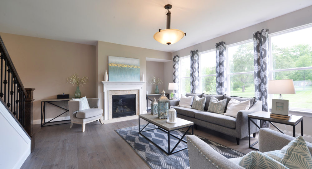 Gathering Room with Fireplace and Natural Light