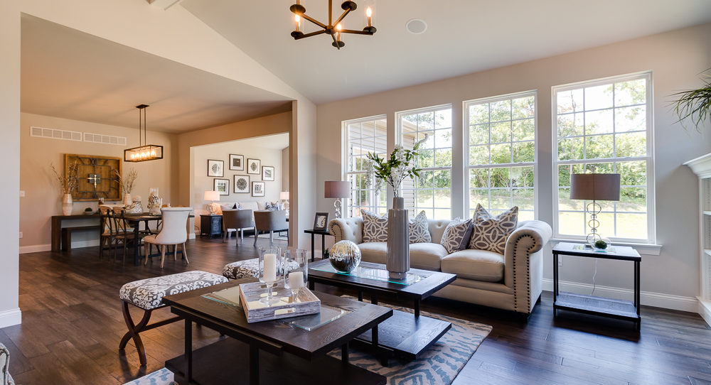 Gathering room with vaulted ceiling and decorative beam