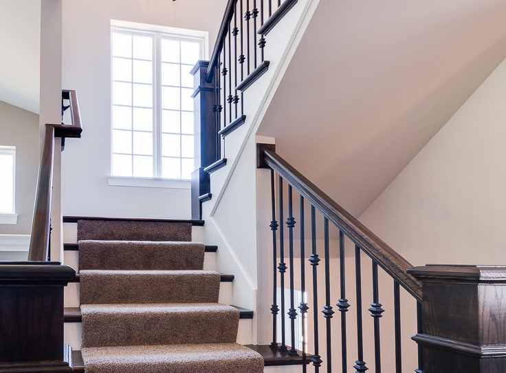 Open staircase with iron spindles