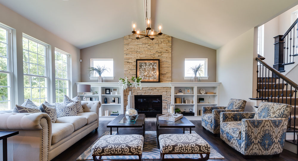 Gathering room with stacked stone fireplace, built in shelves