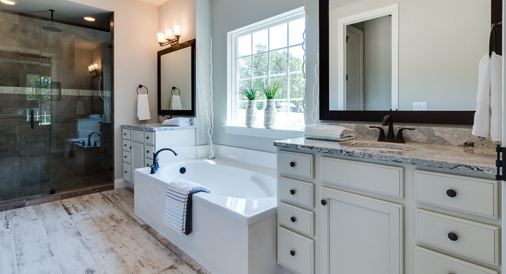 Bathroom with white cabinetry