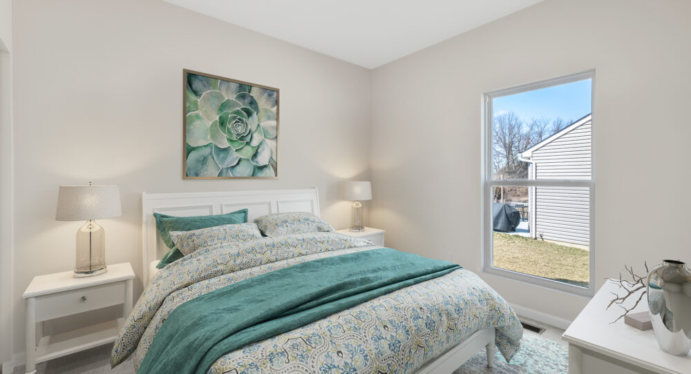 Bedroom inside a new home from Rolwes Company.