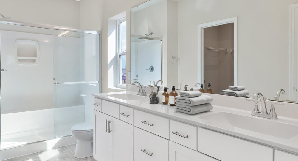 Staged bathroom inside a new home from Rolwes Company.