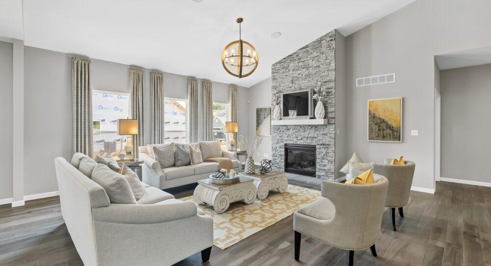 Luxury living room area with wood floors.