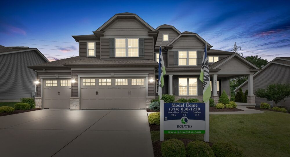 Night time exterior image of a new home from Rolwes Co.