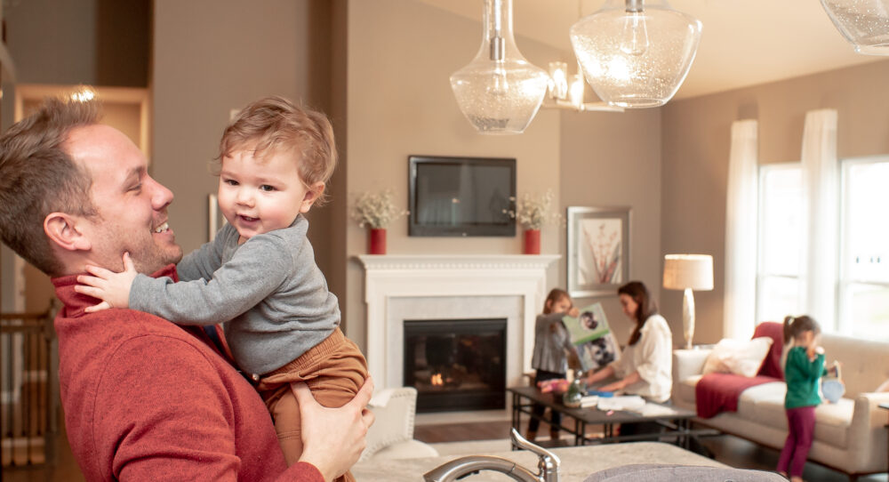 Family in a new home from Rolwes Company.