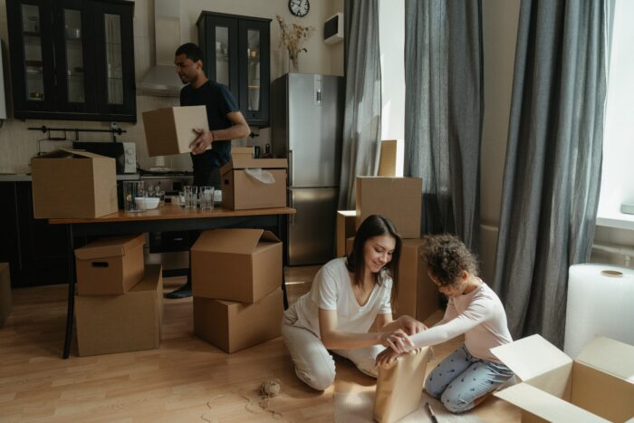 Family Unpacking Boxes in a New Home